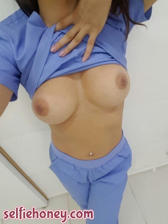 bustynurse1 - Busty Nurse Taking Selfie